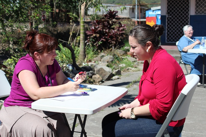 Nicole interviewing a student